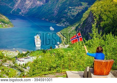 Tourism Vacation And Travel. Female Tourist Enjoying Beautiful View Over Magical Geirangerfjord From
