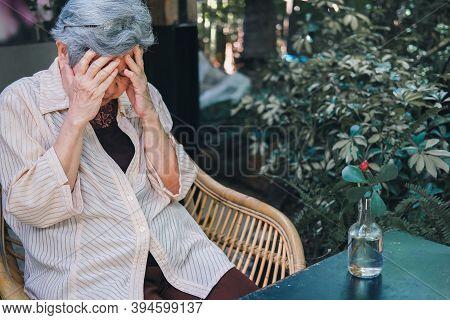Stressed Depressed Fatigued Sad Upset Asian Old Asian Elderly Senior Elder Woman