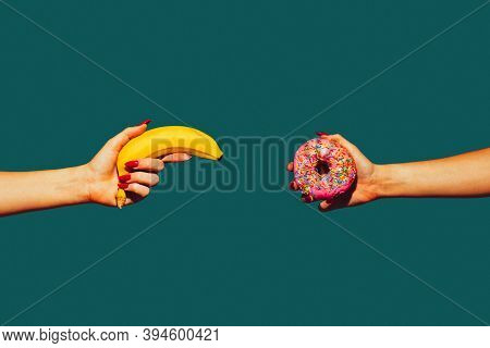 Banana And Donut. Modern Art Collage In Pop-art Style. Hands Isolated On Trendy Colored Background W