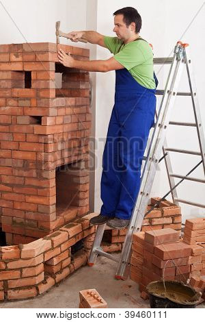 Worker Building Masonry Heater