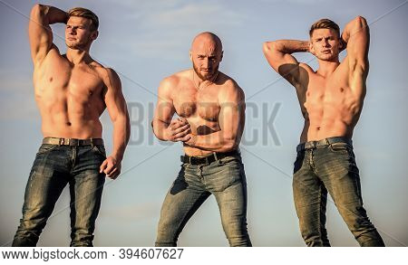 Muscular Means Powerful. Gym Trainer. More Strength More Muscle. Strong Men Blue Sky Background. Sho