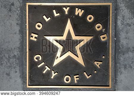 Hollywood, City of L.A. Brass Placard in the cement sidewalk. A brass Star Placard documenting Hollywood, California in the sidewalk. Hollywood is full of interesting people and things to see.