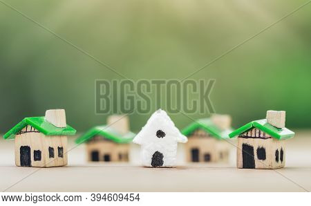 White House In Among Green Houses For Real Estate. Planning Savings Money Of Coins To Buy A Home Con