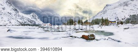 Dramatic Winter Scenery With Snowy  Mountain Peaks  On The Shore Of Rolvsfjord On Vestvagoy Island A