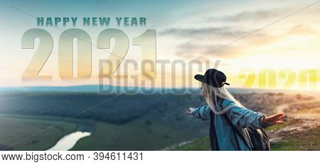 Happy New Year. New Start Resolution. Sunset Of 2020 And Sunrise Of 2021 Year. Young  Girl Holding H