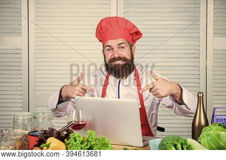 Man Chef Searching Internet Recipe Cooking Food. Elearning Concept. Chef Laptop Read Culinary Recipe