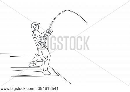 Single Continuous Line Drawing Of Young Happy Fisher Man Fly Fishing Big Bass Fish In Dock Pier. Fis