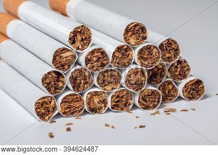 A Cigarette, A Cigarette At The White Background, A Cigarette Pack, A Close-up Of A Cigarette