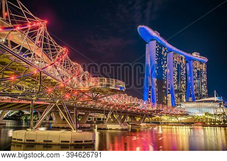 Singapore, November 24, 2018. Marina Bay Sands Hotel From Garden By The Bay In Helix Bridge To Water