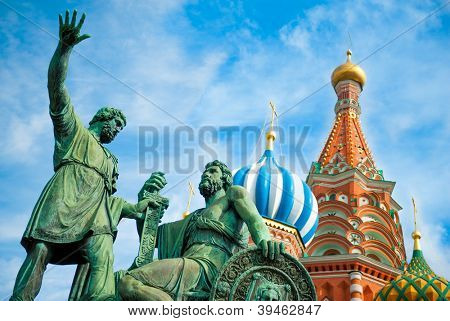 Monument to Minin and Pozharsky on the Red Square in Moscow Russia. Saint Basil's Cathedral on the background. poster