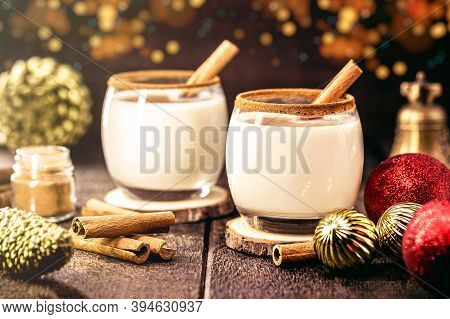 Hot Christmas Drink With Decoration And Christmas Lights In The Background, Called Eggnog, Made With
