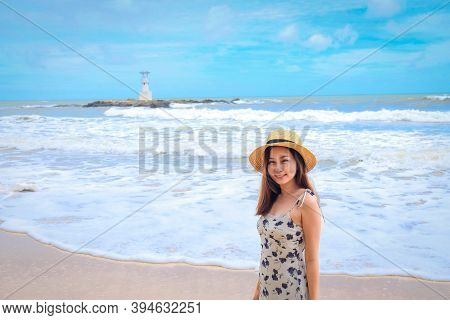Pretty Girl On Swing With Backgound Of Nang Thong Beach In Khao Lak Lighthouse