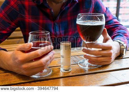 Alcohol In Male Hands In A Bar Close-up. The Concept Of Alcoholism, The Fight Against Alcohol Addict