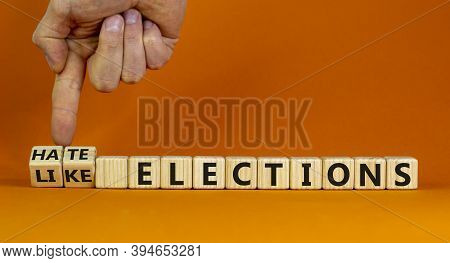 Hate Or Like Elections. Male Hand Flips Wooden Cubes And Changes The Inscription 'like Elections' To