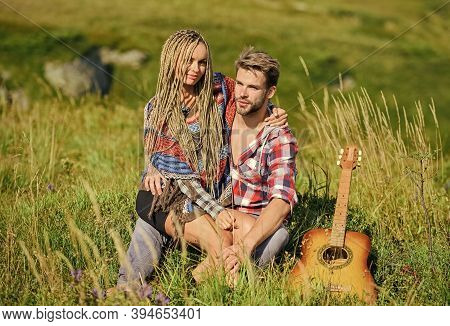 Romantic Hike. Family Hike. Boyfriend And Girlfriend With Guitar In Mountains. Enjoying Each Other.