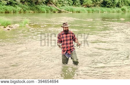 Be Successful. Hobby And Sport Activity. Bearded Fisher In Water. Fisherman Show Fishing Technique U