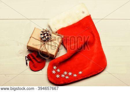 Attributes Of Christmas. Santa Stocking With Christmas Gift Box. Keep Family Traditions. Christmas D