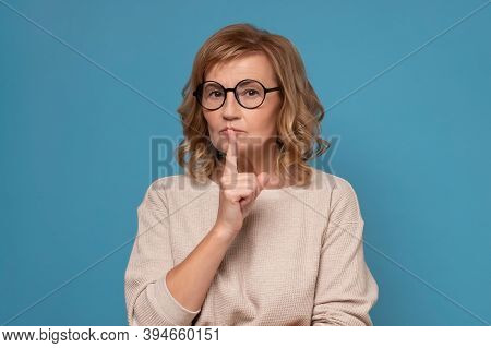 Shh, Keep Silence Concept. Serious Woman In Glasses Gesturing Hush Sign