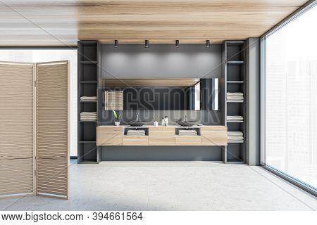 Wooden Grey Bathroom With Two Black Sinks, Big Shelf And Large Mirror Near Big Window. Open Space Ba