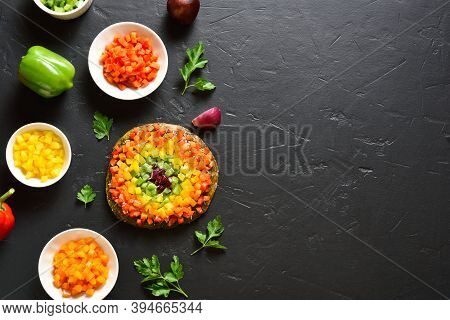 Rainbow Veggie Bell Peppers Pizza On Black Stone Background With Free Text Space. Vegetarian Vegan O