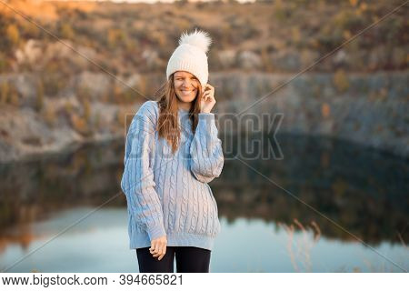 Winter Portrait Of Smilling Woman In White Hat With Big Bubo Makes Funny Face