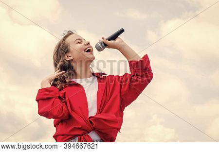 Piece Of Music. Make Your Voice Louder. Teen Girl Singing Song With Microphone. Having A Party. Happ