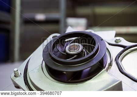 Coolant Pomp Of A Modern Car. The Pump Impeller Is Shown In Close-up.