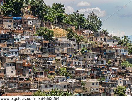 Rio De Janeiro, Brazil - December 24, 2008: Part Of Favela On Mountain Slope Under Blue Cloudscape.