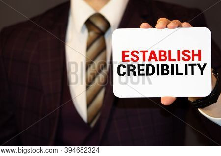 Establish Credibility Word Concept On Sticker On The Keyboard.
