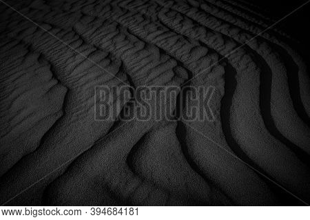 Black And White Sand Beach Macro Photography. Texture Of Black And Whote Sand For Background. Close-