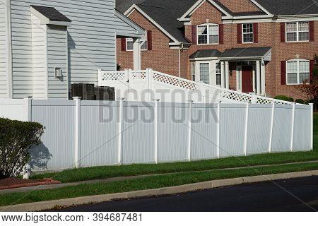 White Vinyl Fence In Residential Neighborhood Home