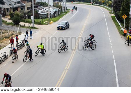 La Calera Colombia - October, 2020: Group Of Amateur Cyclists Crossing The Road Between Bogota And L