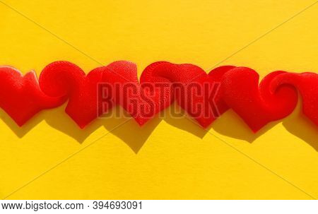 Red Hearts On Yellow Background With Weave And Merge Effect,  Greeting Valentine Heart Shape, Concep