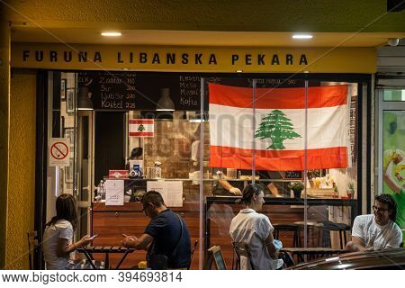 Belgrade, Serbia - September 9, 2020: People Sitting At Tables In Front Of A Lebanese Bakery And Res