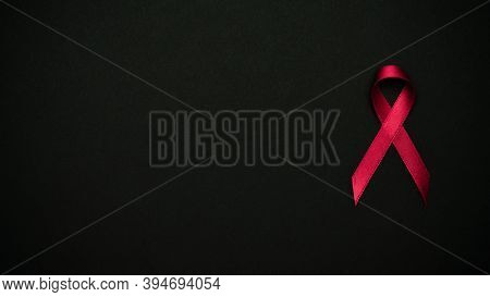 Hiv Support. Red Ribbon Symbol In Hiv World Day On Black Background. Awareness Aids And Cancer. Agin