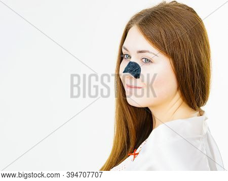 Woman With Nose Mask Pore Strips