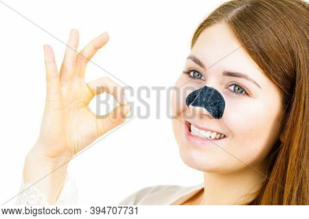 Woman Applying Pore Strips On Nose