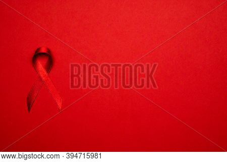 Hiv Day. Red Ribbon Symbol In Hiv World Day On Dark Red Background. Awareness Aids And Cancer. Aging