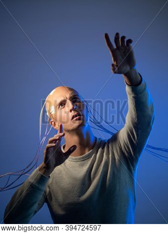Bald Man With Electrodes In His Brain, Futuristic Concept, Transhumanism Idea Of Transferring Consci
