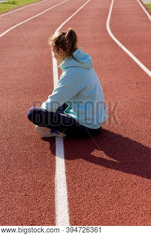 Training On The Street, A Young Female Athlete Makes A Workout On The Street Platform. Female Athlet