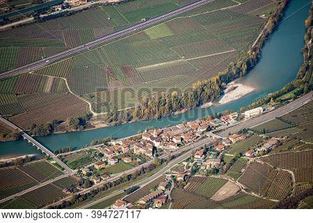 Aerial View Of Adige Valley From The Mountain Peak Of Corno D'aquilio With The Small Village Of Borg