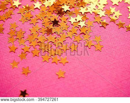 Golden Stars Glitter On Pink Background