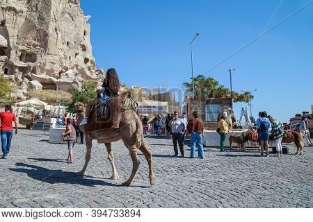 Uchisar, Turkey - October 4, 2020: This Is A Camel And Pony Ride On The Square In Front Of The Rocky