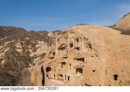 Ancient Cliff Dwellings Of Guyaju Caves In China