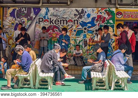 Tokyo / Japan - April 22, 2018: People Playing Pokemon Go In Pokemon Plaza In Front Of The Yodobashi