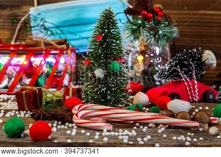Christmas decoration other holidays symbol on table with protective mask