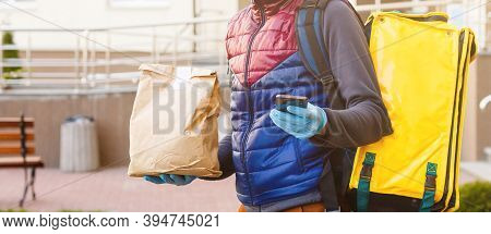 Contactless Food Delivery To Customers Home. Delivery Service Worker With Thermal Backpack Quick Del