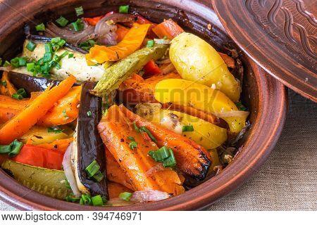 Vegetarian Dish, Homemade Tajine Or Tagine With Potatoes, Eggplants, Zucchini And Pepper, Close-up -