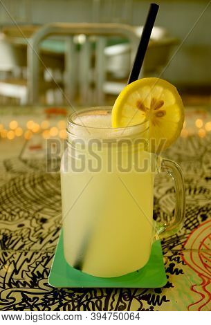 Glass Of Mouthwatering Lemonade With A Slice Of Fresh Lemon