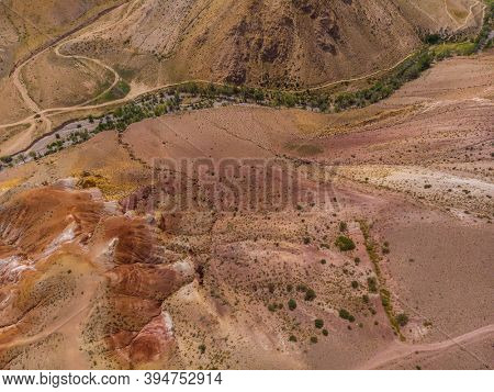 Aerial drone view of colorful eroded landform of Altai mountains in popular tourist location called Mars, Chagan-Uzun, Altai Republic, Russia